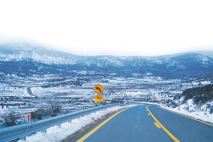 High-risk curves on mountainous roads can be easier for drivers to manage when they have adequate signage and barriers.