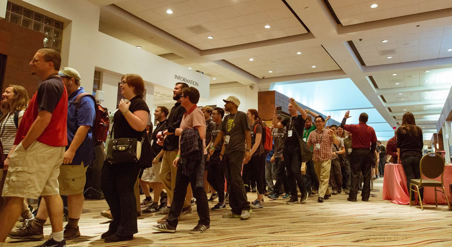 A long line of developers walk through the Palm Springs Convention Center. More than 1,800 people attended the event in Palm Springs.