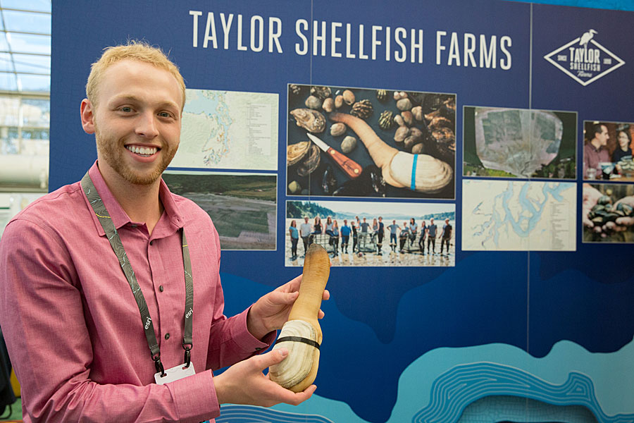 Nyle Taylor holds up a geoduck.