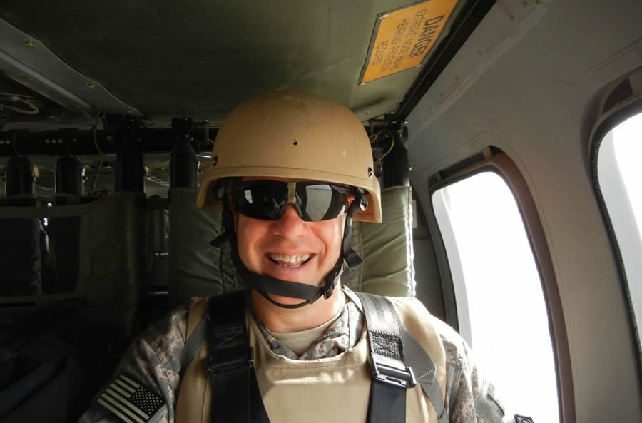 John Berry rides in a Blackhawk helicopter over central Iraq.