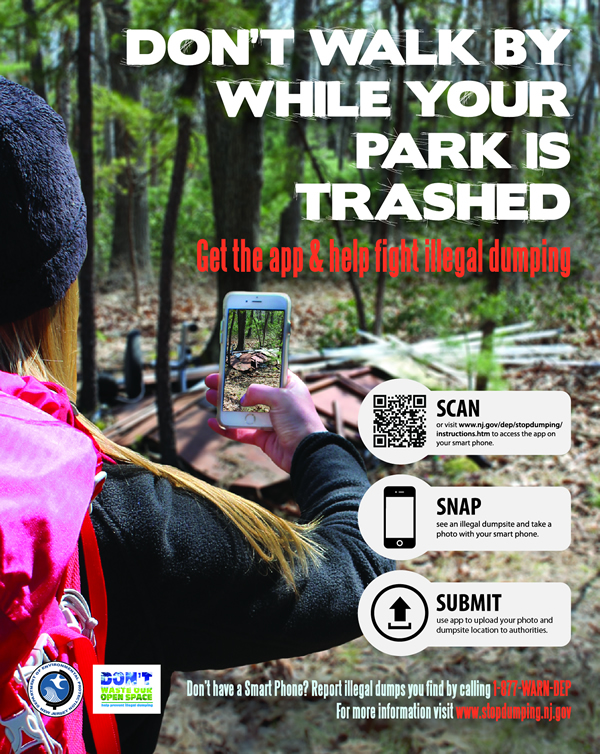 A poster advertises the browser-based app that people can use on their smartphones to report illegal dumping.