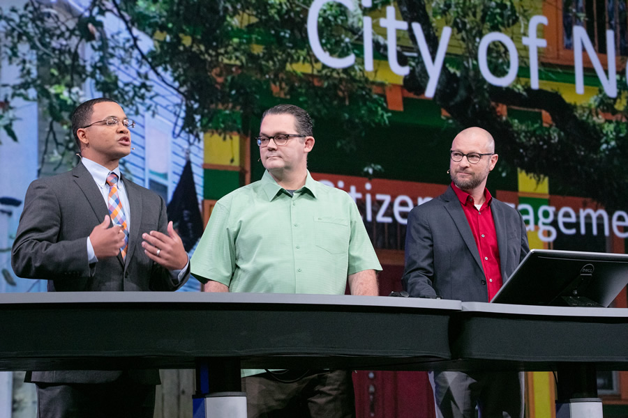 Lamar Gardere (left), J.B. Raasch, and Gregory Hymel from the City of New Orleans talk about how they use Esri technology to spur citizen involvement in making the city a better place to live.