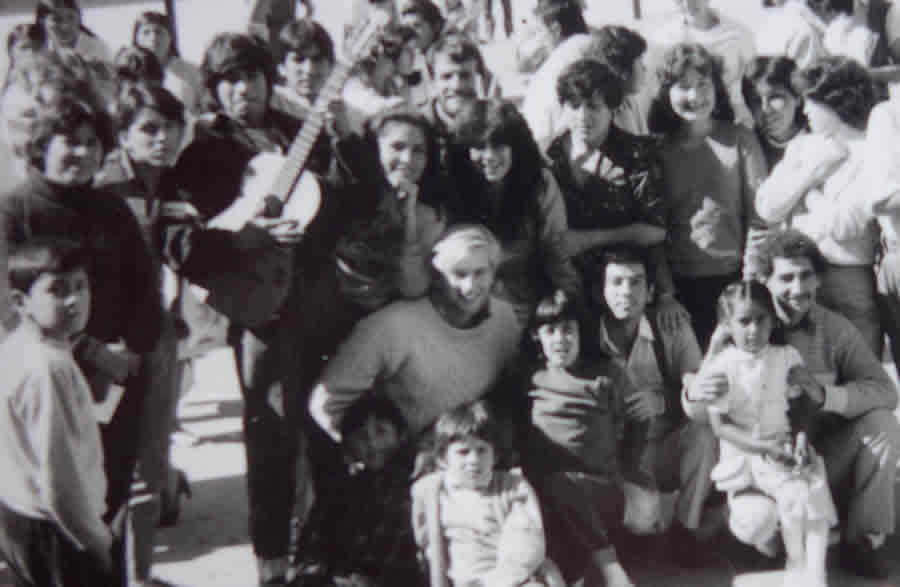 This photograph is a memento from Richard Resl's trip to Bolivia 30 years ago. He's surrounded by a group of young people in the main plaza in Tarija, Bolivia. Photo courtesy of Richard Resl.