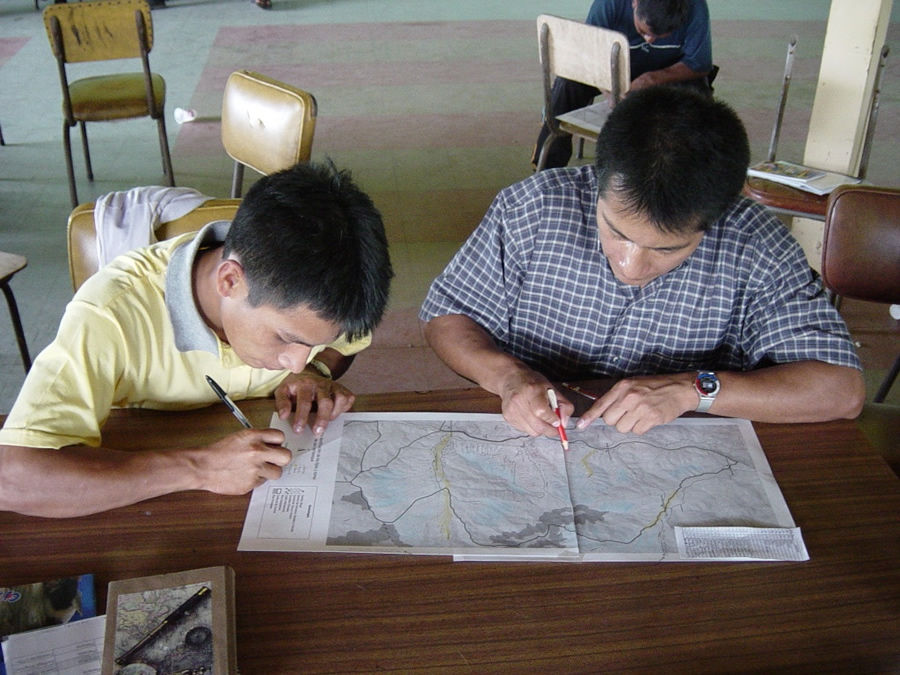 Young men create life plan maps in the Shuar territory of Cordillera del Condor in 2008. Photo courtesy of AmazonGISnet.