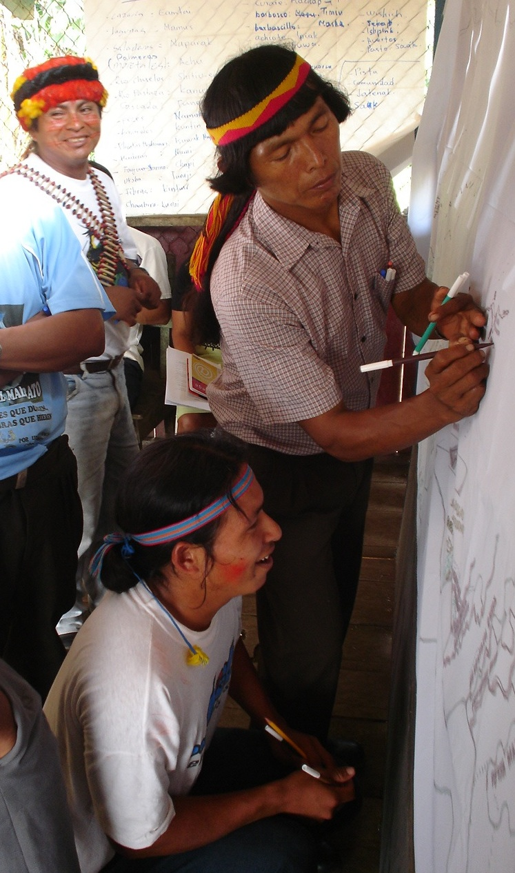 Achuar leaders draw their land use maps. Photo courtesy of AmazonGISnet.