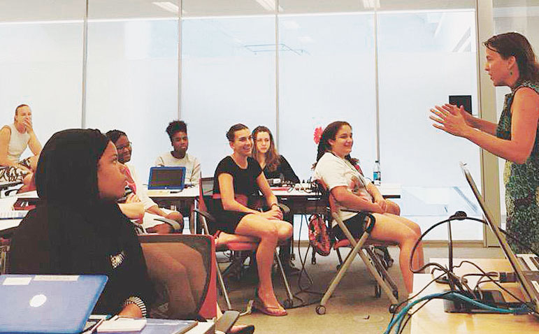 Dr. Coline Dony (far left) led a Girls Who Code Summer Immersion Program in Washington, DC, which National Public Radio's lead developer, Joanne Garlow (right), joined as a guest. (Photo courtesy of Coline Dony.)