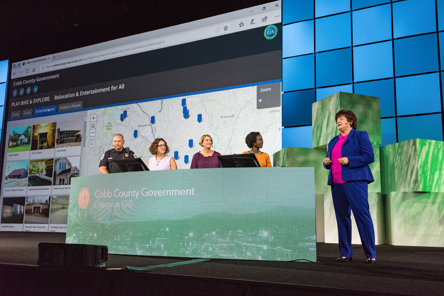Sharon Stanley (standing to the far right), director of the Information Services Department for Cobb County, talked about the importance of making the county's enterprise GIS easy enough for people outside the GIS department to use the technology.