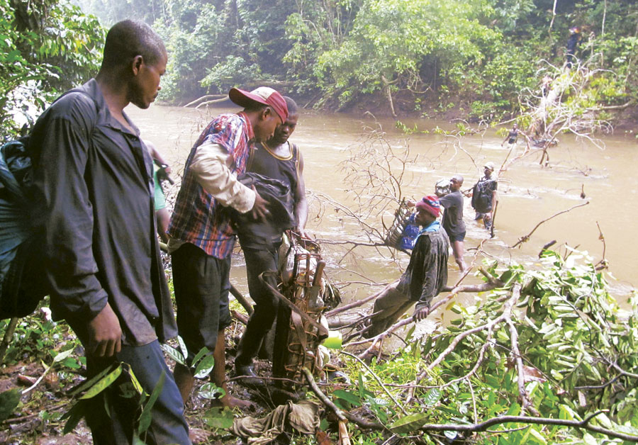 Congolese field biologists used GIS to collect field data all over this unexplored wilderness—sometimes having to form human supply chains to get all their materials across rivers.