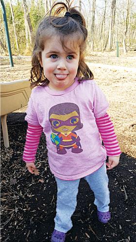 Two-year-old Lena, is wearing a Map Girl Esri T-shirt
