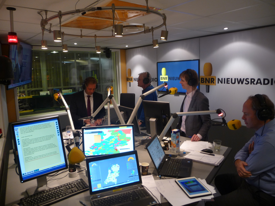 Inside the BNR Nieuwsradio studio, computer screens displayed the election results using maps and widgets created with Esri's Operations Dashboard for ArcGIS.