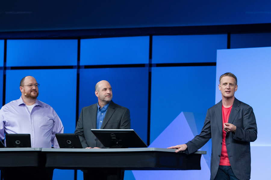 Esri's John Calkins (right) introduces Anthony Vazquez and David Wright from Hartsfield-Jackson Atlanta International Airport. Wright and Vazquez talked about how web GIS helps airport staff better manage operations.