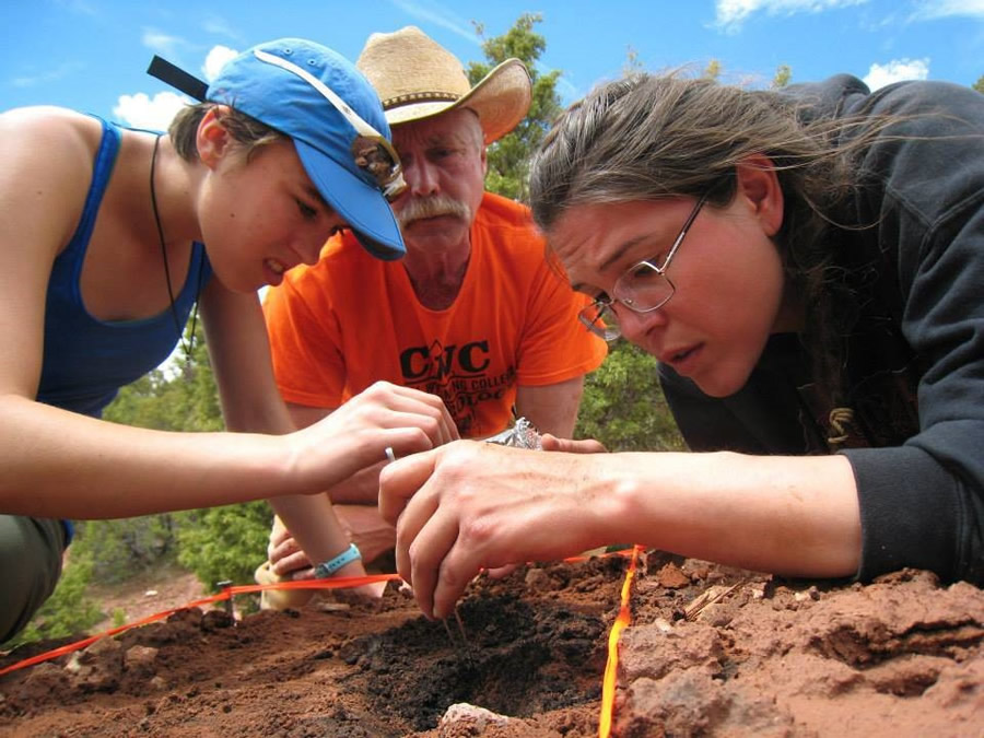 Morgan Robins (left), a GIST/archaeology student, Todd Guenther (center), a CWC archaeology faculty member, and GIST/archaeology student Starla Ramirez (right), conduct archaeological field work. Students from the CWC archaeology program use ArcGIS to prepare maps for the US Bureau of Land Management, which funds their summer field work.
