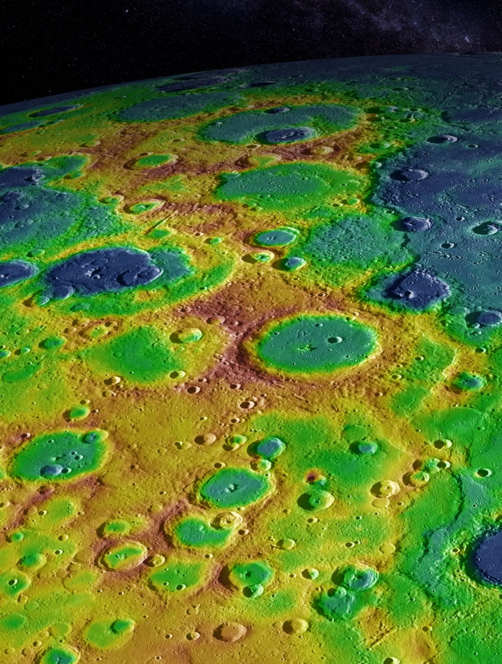 "This image shows Mercury's surface with elevations color-coded from high to low terrain. A series of cliff-like scarps along the right-hand side of the image form what scientists term a ""fold and thrust belt."" (Image Credit: NASA/Johns Hopkins University Applied Physics Laboratory/Carnegie Institution of Washington)"