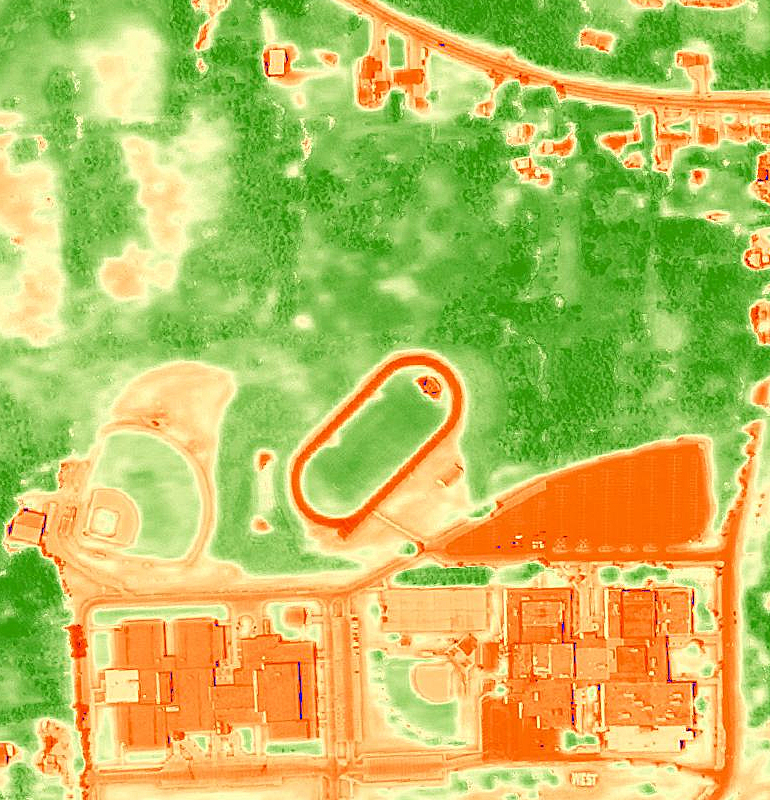 This high-resolution aerial imagery from the Normalized Difference Vegetation Index (NDVI) shows vegetation in contrast to built areas around a residential neighborhood in the United States.