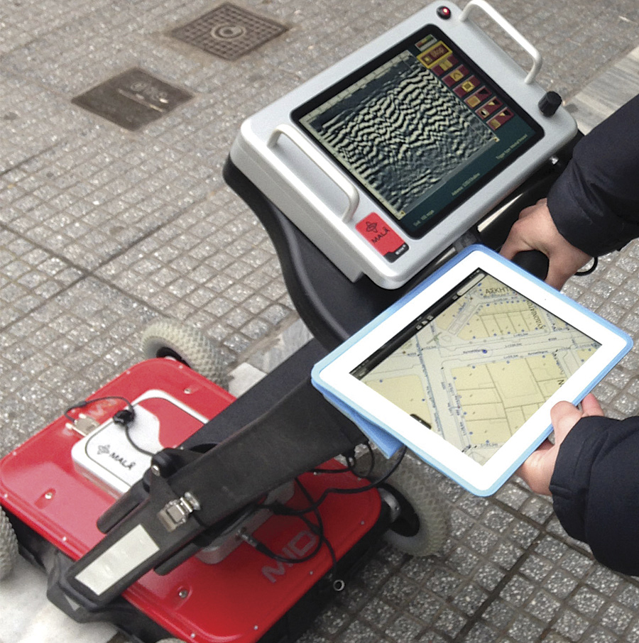 Aided by mobile GIS, an EYATh employee uses a ground-penetrating radar device to more accurately identify underground network assets.