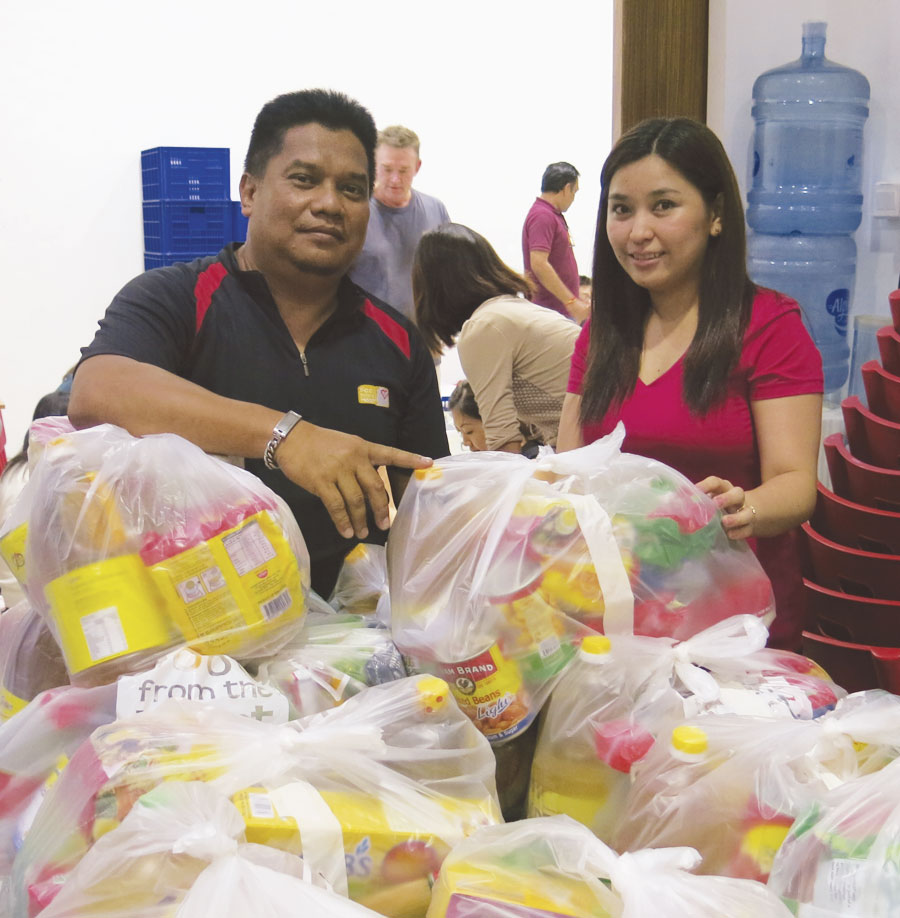 Food from the Heart (FFTH) volunteers pack deliveries for more than 14,500 needy individuals and families around Singapore.