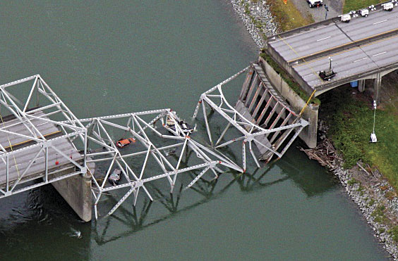 Part of the Skagit River Bridge collapsed when a tall semi-truck, driving in the wrong lane, struck its trusses.