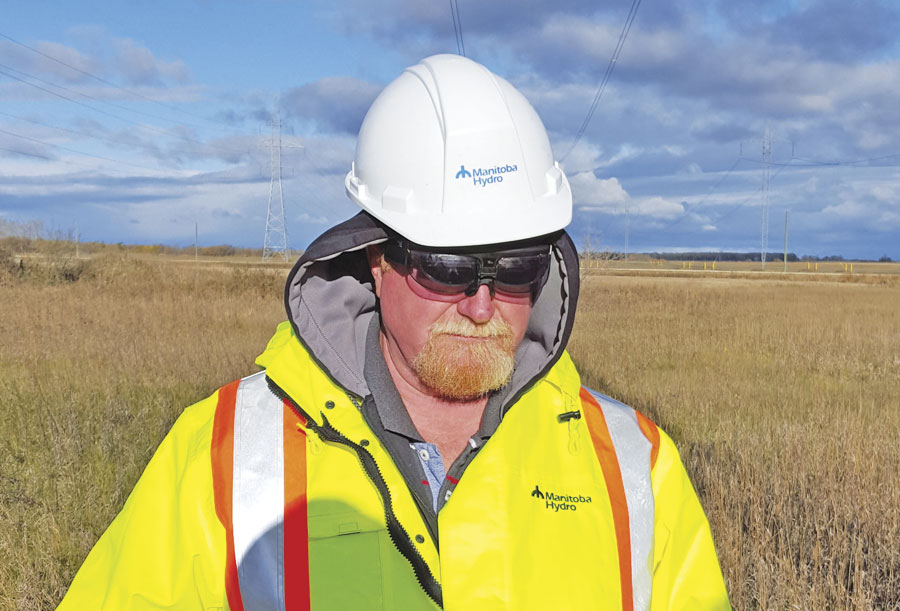 A fieldworker for Manitoba Hydro, a major energy utility in Manitoba, Canada, uses VisualSpection augmented reality smart glasses to record GIS information about a power line corridor.
