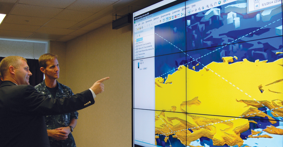 Rear Admiral Timothy C. Gallaudet, commander of the Naval Meteorology and Oceanography Command, with Brian Lehman of the Esri Defense team, discussing the marriage of ocean science and GIS.