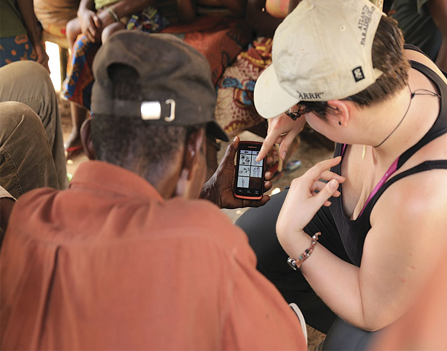 Although few tribal members had seen a cell phone, the ExCiteS team ensured that local populations could easily use the application. (Photo courtesy of Jerome Lewis.)
