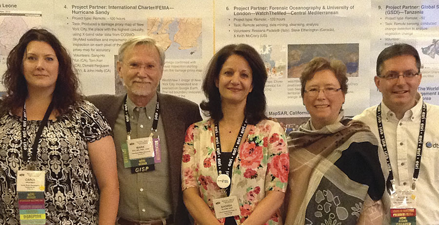 Shoreh Elhami (center) with GISCorps Core Committee members (from left to right) Carole Kraemer, Mark Salling, Dianne Haley, and Allen Ibaugh.