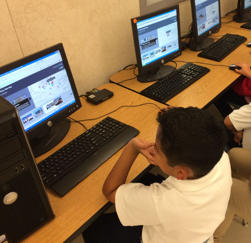 Students at Competitive Edge Charter Academy in Yucaipa, California, use their computers to view story maps.