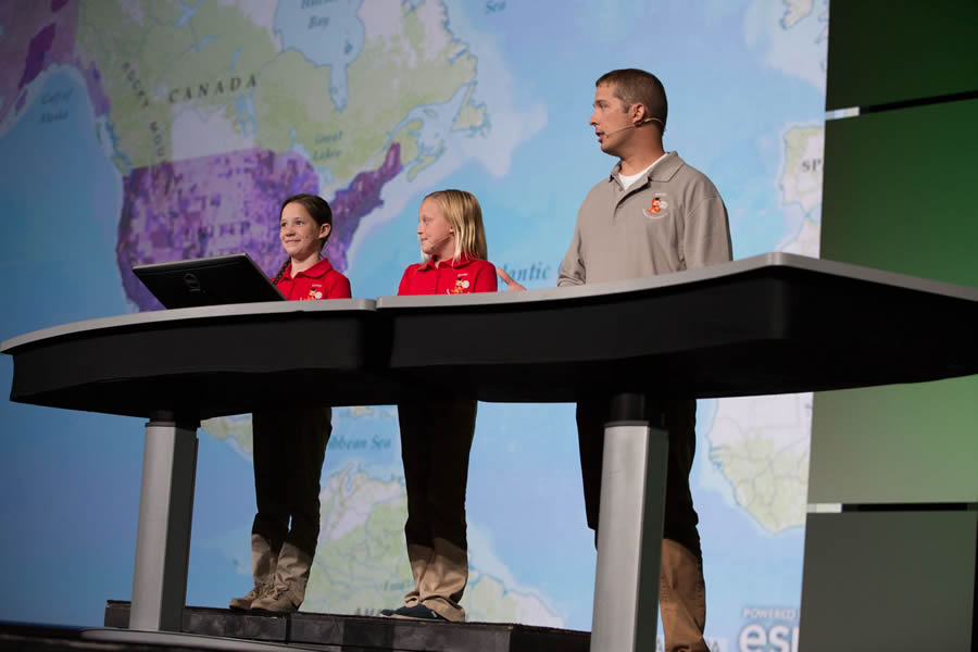 Fourth graders Rikki Vaughn (left) and Kylie Miller, with their teacher Josh Worthy, spoke at the Esri User Conference about how they used ArcGIS Online for class projects. The students attend Sonora Elementary School in Springdale, Arkansas.