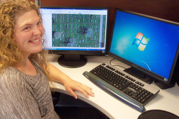 Cassie Jorgenson uses ArcGIS to map East Side Cemetery. Photo by Troy Maggied.