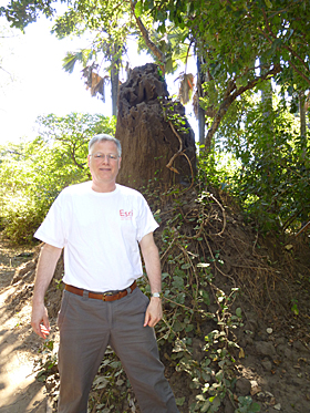 Gregg Gohrband wore his Esri t-shirt in front of a nine foot tall termite mound