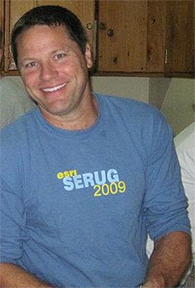 Herrick A. Smith wearing an Esri SERUG 2009 shirt