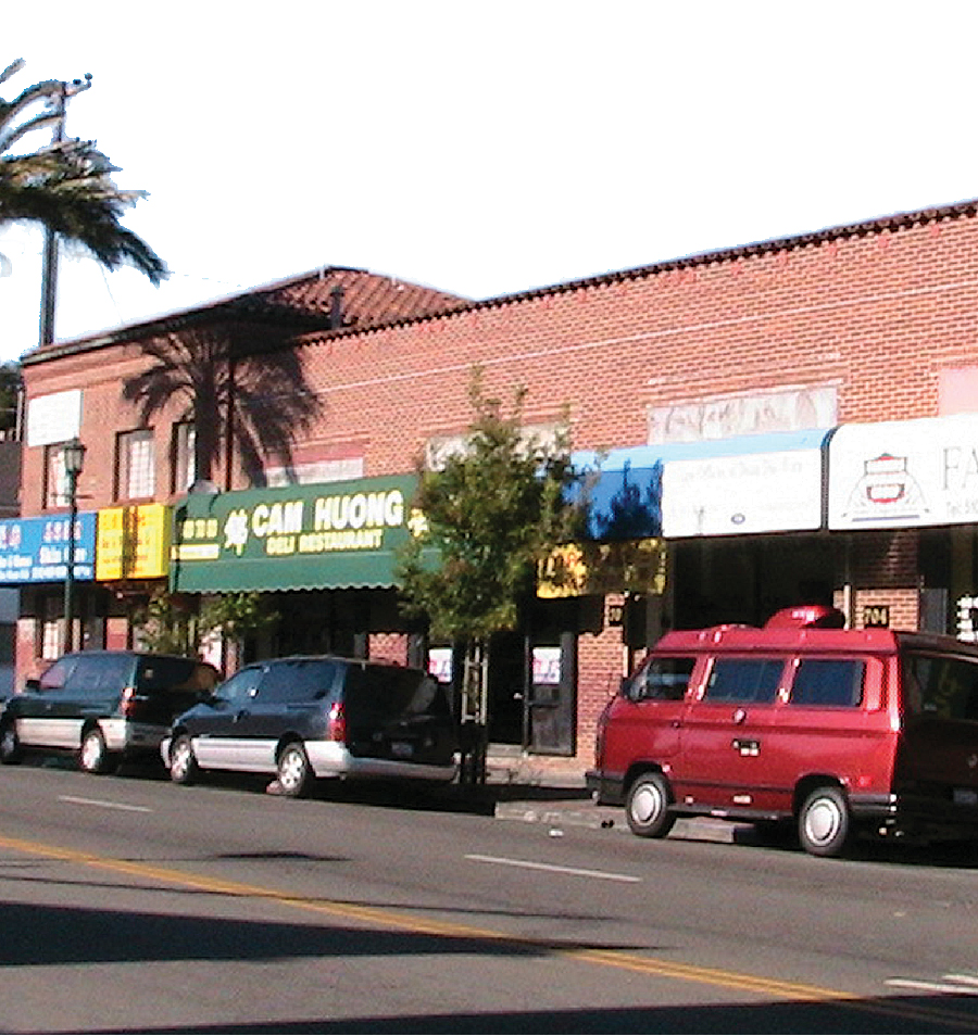 Flat-roofed building types varied in design and use and included retail shops, apartment buildings, and big-box retail locations.