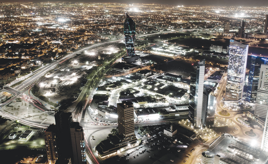 Kuwait city at night showing electricity and streetlights distributed around the city. (Photo: Mohammed Hachem Aouad.)