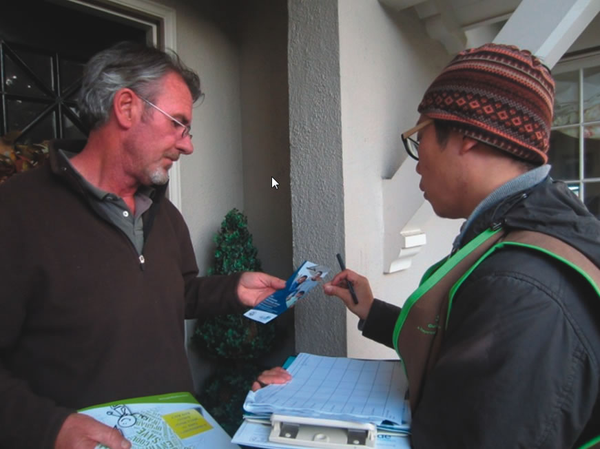 Door-to-door sales staff engaged homeowners by explaining the energy program and providing collateral.