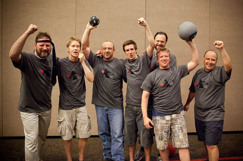 The Balls, last year's dodge ball tournament winners, gloat about their triumph. Yes, that's a necktie headband.