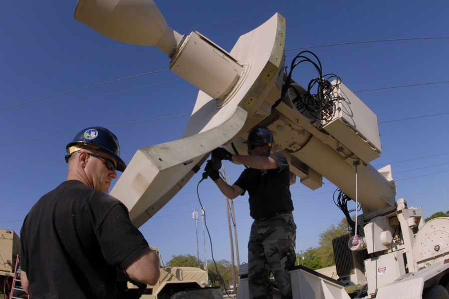 Master Sergeants Troy Wilkerson and Ed McManus prep Eagle Vision's satellite antenna to receive raw imagery for processing. (Photo by Senior Master Sergeant Edward E. Snyder and courtesy of www.nationalguard.mil)