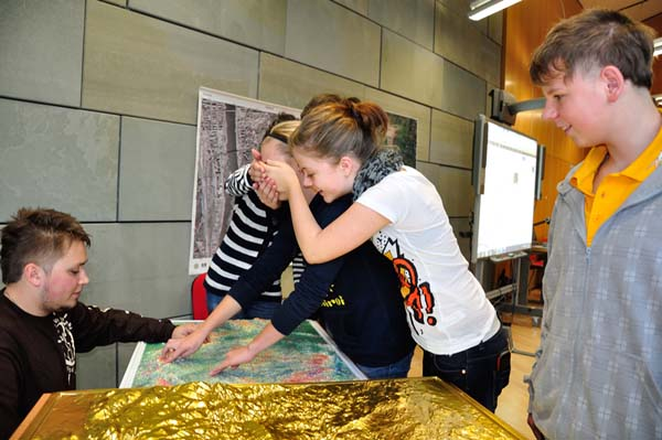Students from the Vrchlického Elementary School in Liberec test their orientation skills using relief maps of the Czech Republic.