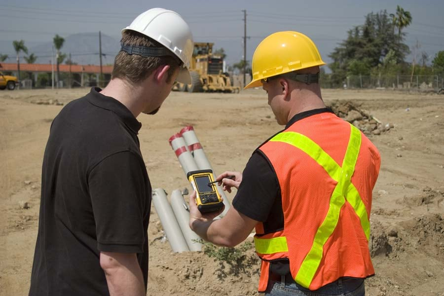 Workers collect data using ArcPad 10.2 on a Trimble Nomad device.