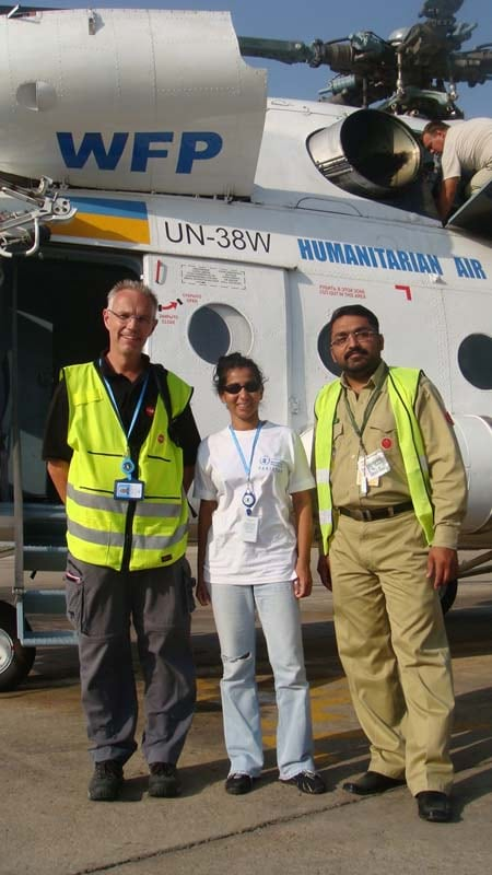 Nadika Senadheera stands with her colleagues in front of a Humanitarian Air helicopter that dropped food to the Pakistanis during the 2010 floods.