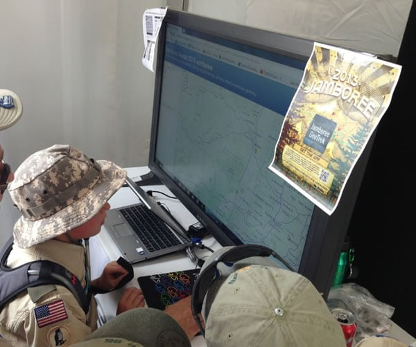 A group of Boy Scouts use an app available in ArcGIS Online to see the hometowns of their fellow scout troops.