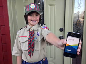 Cub Scout Joshua Perry prepares to collect sales information using Collector for ArcGIS.