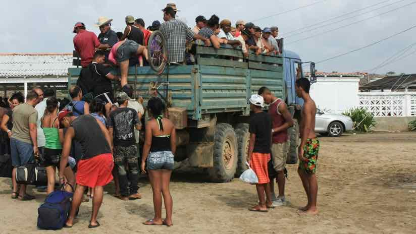 central american refugees board a truck