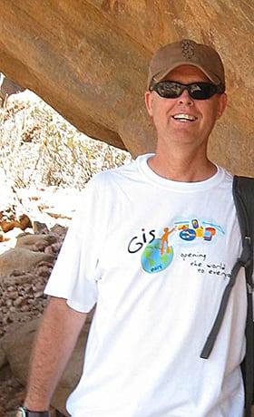 Dean Lambert professor of geography, wears his Esri T-shirt while visiting Laas Gaal