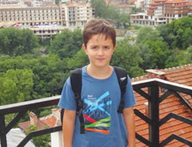 Mariyana Kostov, GIS manager a photo of her son wearing his Esri T-shirt in the city of Veliko Tarnovo in Bulgaria
