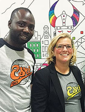 Paul Ajayi and Jessica Leonard students model their Esri T-shirts