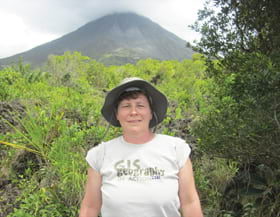 Peggy Staske, an engineering information technician posed in her Esri T-shirt at the Arenal Volcano in La Fortuna