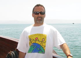 Ray Postolovski, US topo production manager wore his Esri shirt while sailing the Sea of Galilee off the shores of Tiberias, Israel
