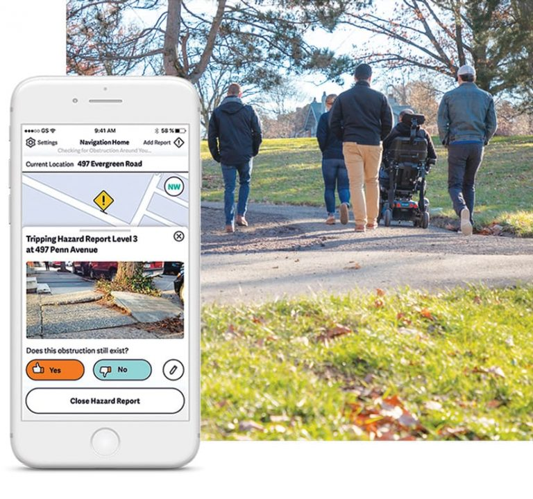A phone screen with a map showing a sidewalk hazard and a photo of four people walking and one person in a wheelchair