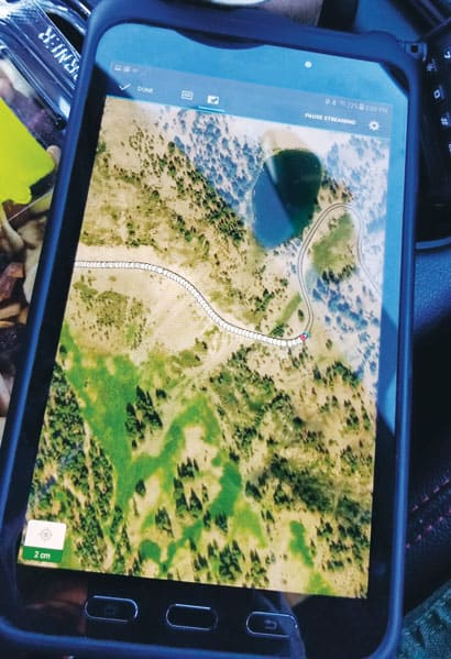 A Samsung tablet showing the new road map on satellite imagery