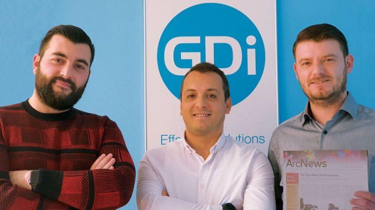 A photo of the three-person GDi team