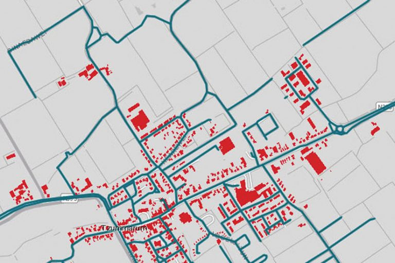 A map with some streets highlighted in blue and some buildings highlighted in red
